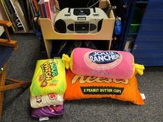 Listening Station with comfy Movie Theater Candy pillows! I NEED THESE PILLOWS!! @ Leisha - These would be great for the pillow reward idea I was telling you about!  Wonder where they got these?