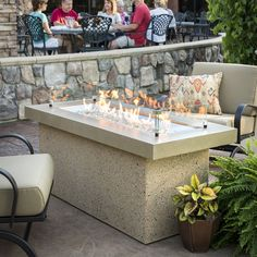 A showcase of fire, the Key Largo gas fire pit features a beautiful, glowing fire that dances atop a bed of fire glass. The focal point of the design is a striking X stainless steel Crystal Fire burner. This simple, modern design will look great i Outdoor Fire Pit Table, Propane Fire Pit Table, Gas Fire Table, Outdoor Living, Outdoor Spaces, Natural Gas Fire Pit, Fireplace Stores, Wood Burning Fire Pit, Modern Pergola