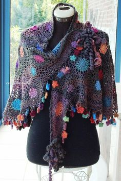 No pattern-could be done with different flowers and put together with crochet mesh.