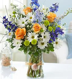 Summer Dunes™- Long-stem roses, daisy poms, button poms and delphinium with wild bear grass, monte casino and variegated pittosporum $49.99- $69.99 #summer #flowers #beach