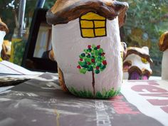 53...the red roses are painted in the rose bush on the fairy house and some grass added at the base of the rose stem