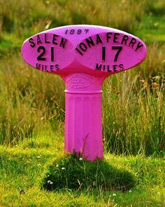 Pink road sign on Isle of Mull, Scotland, United Kingdom.