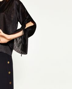 BLOUSE WITH CORD ON SLEEVE