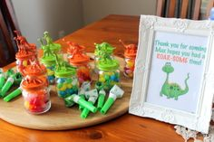 CatchMyParty.com__quickie goodie bags: jelly beans, dollar store container, and spray painted dinos glued to tops.