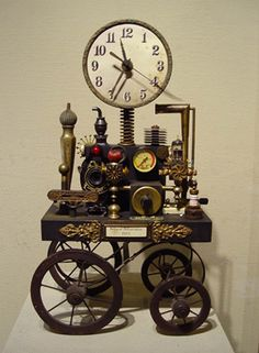 """""""Clock on Wheels"""" - Unique Timepieces by Roger Wood, via Lanning Gallery;  """"To me they're sculpture disguised as clocks,"""" Wood says, referring to his work."""