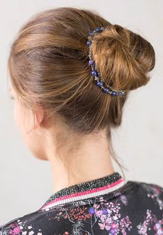 "Beaded hairband with vibrant purples and silvertone. Colored beads may vary. Download the Stylist Marketing Pack for this product. Plating: Nickel Glass Beaded length: 16 inches / 40.5cm Removable adjustable elastic band Elastic Color: Available in Black, Blonde, Brunette, or Silver Elastic Length Standard: 4-5"" (10-13 cm), up to 6.5"" stretched Elastic Length Long: 5.25-7.5"" (13-19cm), up to 10"" stretched ..."