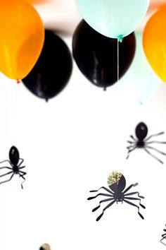 DIY Gold Glittered Hanging Spider Balloons...love the black-mint-orange color combo, too!  {Studio DIY}