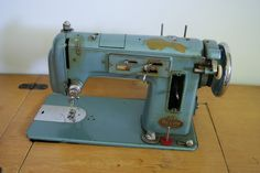Automatic Zig-Zag International 205 DeLuxe  Made: I'm guessing late 50s/early 60s ???  With original sewing cabinet, the sewing machine tucks down into the cabinet for storage.