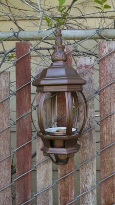 Repurposed our old white lamp post into a bird feeder! :)