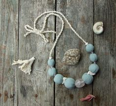 Tender necklace with light blue soft textile beads by TextileBijou