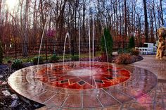 Splash pad by day, patior for entertaining by night.  Google Image Result for http://www.midwestcustompools.com/Portals/140741/images/splash%2520pad.jpg