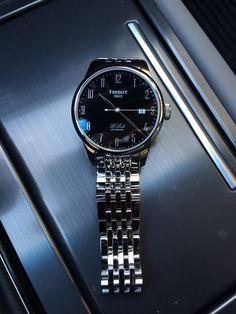 TISSOT LE LOCLE MEN'S AUTOMATIC ARABIC NUMBERALS BLACK DIAL WITH STAINLESS STEEL BRACELET Item number T41148352