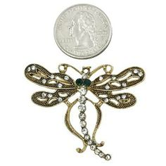 Burnished Goldtone Rhinestone Dragonfly Brooch Pin PammyJ Brooch Pin. $9.99. Lead Compliant. Great Fashion Accessory. Comes In Foil Gift Box. Perfect For Gift Giving. Save 63% Off!