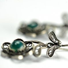 Unique earrings with green stone -Unique handmade silver earrings in flower shape with a green stone.