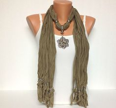 brown jewelry scarf with very pretty pendant