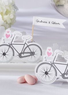 Send your guests home with their own sweet ride. This two-sided, vintage cruiser features a waving flag for a place card as well as a pop-up favor box that can be filled with yummy treats. Style 28192NA at #DavidsBridal #pinkweddings #weddingfavors