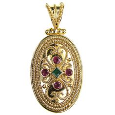 Damaskos 18k Gold Ruby and Emerald Iraklion Pendant. 18k Gold, Rubies and an Emerald. See more Greek jewelry at www.athenas-treasures.com