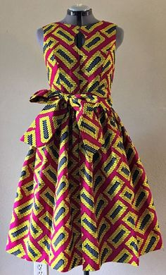 Quirky Fall Dress African Wax Print Keyhole Bodice Fit and Flare 100% Cotton Hot Pink Yellow Black Geometric Print With Pockets and Belt. Ankara | Dutch wax | Kente | Kitenge | Dashiki | African print bomber jacket | African fashion | Ankara bomber jacket | African prints | Nigerian style | Ghanaian fashion | Senegal fashion | Kenya fashion | Nigerian fashion | Ankara crop top (affiliate) #Africanfashion