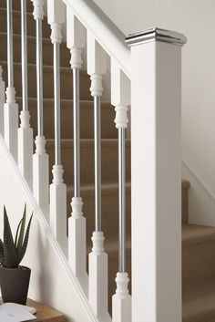 contemporary wood banisters   Axxys Solo White Primed with Chrome Click here to Purchase