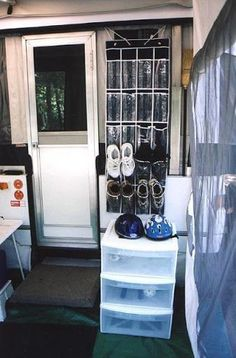 Shoes by the door- more room in the trailer this way. Keep it cleaner with the kids.  Like this idea for toys, shoes, helmets.