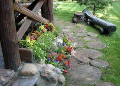 allées-jardin-rondins-bois-banc-fleurs