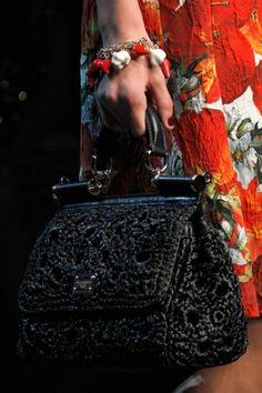 From the Dolce & Gabbana SS12 show.  It's cute but do people carry purses by hand much?  Seems like a hassle