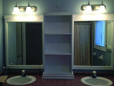 large bathroom mirror redo to double framed mirrors and cabinet, bathroom ideas, home decor, shelving ideas, bottom of cabinet dressed then realized I needed more height to cover the original light hole grrr Large Bathrooms, Amazing Bathrooms, Small Bathroom, Bathroom Ideas, Downstairs Bathroom, Modern Bathroom, Bathroom Remodeling, Cozy Bathroom, Bathroom Updates