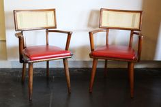 Mid century cane-backed chairs with new cane and red, salvaged leather seats.