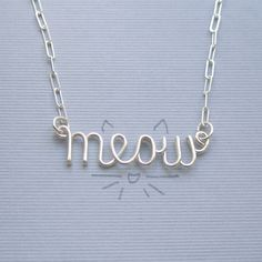 A little something cute for a kid sister, baby sitter, tween on your list. Tons of words to choose from. meow necklace  all sterling silver by PianoBenchDesigns on Etsy, $36.00
