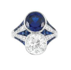 Art Deco Platinum, Diamond and Synthetic Sapphire Ring One cushion-shaped diamond ap. 2.25 cts., c. 1920, ap. 3.5 dwt
