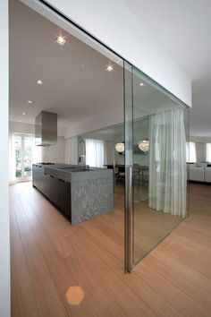 Attico in Roma by Carlo Colombo | Living space  glass sliding doors