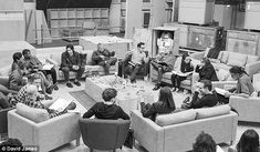Already on the job: Fisher, pictured far right as she chatted with newcomer Daisy Ridley, was in London in April for the Episode VII table read