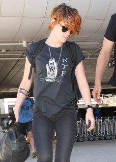 Kristen Stewart shows off her shorter hair at LAX on July 24, 2014. Check out the many celebs spotted at LAX (Los Angeles Int'l Airport)! http://celebhotspots.com/hotspot/?hotspotid=4954&next=1