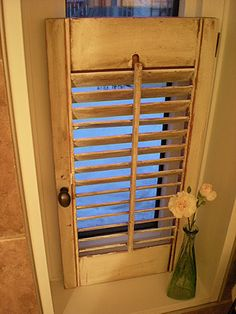 shutter over bathroom window. Perfect for quarter bathroom off of kitchen!!