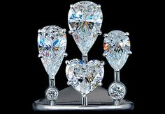 WEDDING HIGH JEWELLERY RING  18K white gold  1 pear diamond 1,98-2,01 ct  1 pear diamond 1,47-1,5 ct  1 heart diamond 1,36-1,39 ct  1 pear diamond 1,0-1,03 ct  23 diamonds 0,22-0,25 ct  15 rubies 0,05-0,07 ct