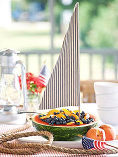 Adorable summer table decor (Fruit Salad Sailboat)!