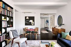 """""""My husband is a huge fan of midcentury modern, and I had to convince him that we could not be midcentury 'purists' if we wanted to maximize our level of comfort,"""" says homeowner and interior designer Bryan Graybill of the eclectic mix of pieces that appear in the living room 
