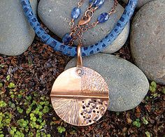 "Olio Pendant Necklace Instructor: Kat Clark Workshop Fee: \ $35 Sunday, September 25 (1-4pm) Olio Pendant Necklace is all about technique and working metal. Students will create a pendant with a ""sampler"" of various textures on metal, plus learn a ""cold"" forming trick. Beaded chain and a leather connector complete this stunning jumble of materials and techniques. Previous metal working and wire wrapping experience is helpful but not required. Materials list."