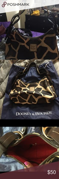 Vintage D&B Giraffe print Satchel Beautiful bag authentic very good condition except the leather piece to pull the zipper open and closed has come off. You are not going to see this bag everywhere. Dooney & Bourke Bags Satchels
