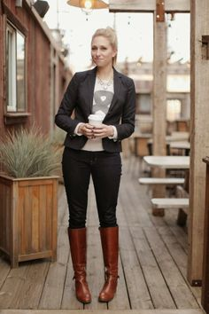 Blazer with a printed tee, dark jeans, boots