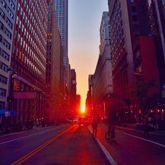 """gigi_nyc on Twitter 20170601: """"Give me the splendid, silent sun with all his beams full-dazzling.""""~Walt Whitman  .  .  06.01.17  """"A beautiful Manhattanhenge sunset in New York City on the first day of June.  .  After several days of rain and clouds, the sun came through today and tumbled between the buildings of the city.  .  You only get a few seconds of clicks each time the light turns red so you can dodge the traffic, and the sun comes down so fast. Glad to have caught it…"""