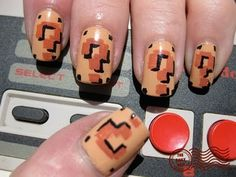 8 ways to geekify your wedding day nails | Offbeat Bride  Mario themed nail art.Again, perfect.