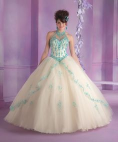 Beautifully made, this Mori Lee Vizcaya Quinceanera Dress Style 89001 is sure to radiate the room during a Quince girl's Sweet 15 party. Made out of tulle, this quinceanera dress features a sleeveless