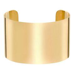 Manchette en métal poli doré, YVES SAINT LAURENT, 350 €