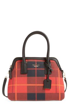 The splash of red plaid on this Kate Spade satchel is sure to add a daring edge to the wardrobe this season.