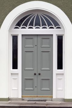 Gray Grey Front Door. Glass sidelight panels on both sides with arched glass transom above.