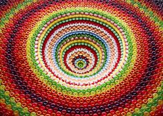 sam kaplan builds food pits and pyramids with candies, cookies + tea cakes candy crush(??!!)
