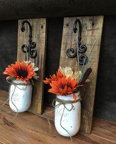 Mason jar wall sconces I made out of pallet wood and mason jars. #BJRusticWoodandGlass #ReclaimedWood #PalletWood #MasonJars #RusticDecor