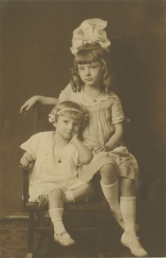 +~+~ Vintage Photograph ~+~+  Sisters Mauricia and Elvira c. 1920 Oklahoma.  Mauricia wins the biggest hair bow contest!
