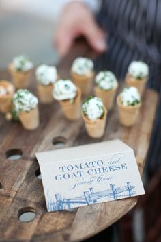 Yum tomato goat cheese cones & smart to have a card explaining what's being passed